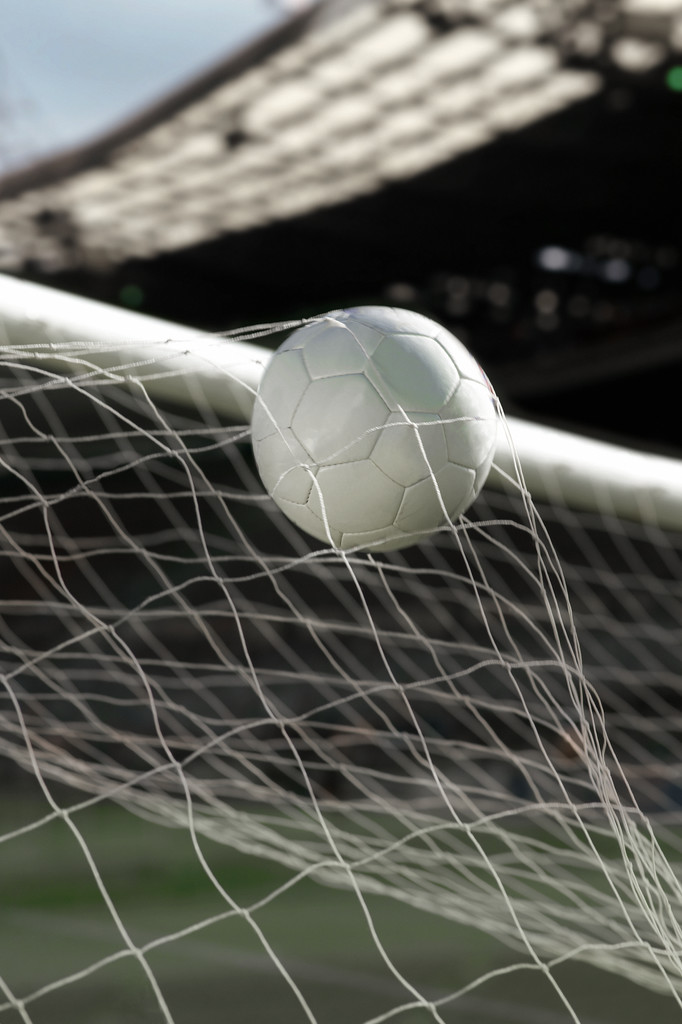 Soccer ball entering the net